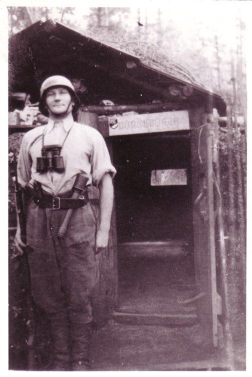 Forest Brother Jaan Roos in front of the door to Põrgupõhja bunker.